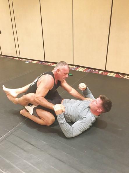 Alex Davis treinando um atleta